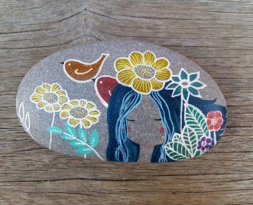 taller de pintura sobre piedras
